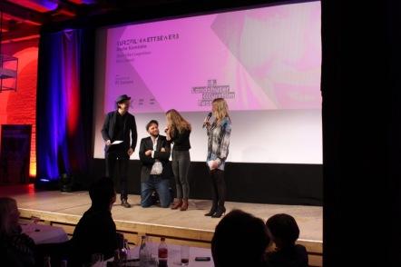 Die drei Juroren Florian Eichinger, Cornelius Conrad und Kiri Trier auf der Bühne der Preisverleihung